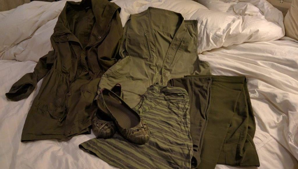 One set of travel basics is an olive green color scheme